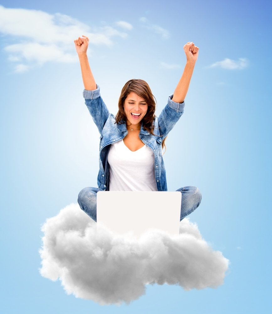Successful woman using cloud computing with her laptop.jpeg